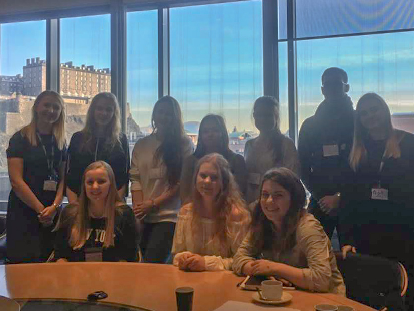 Erasmus students at Standard Life with Edinburgh Castle in background