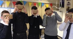 Students where Google cardboard VR headsets