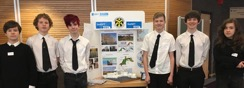 Pupils in front of a display of their art work