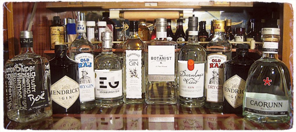 A selection of Scottish gin bottles on a bar.