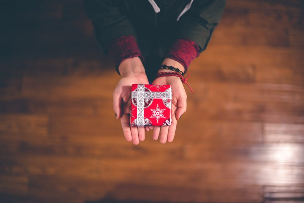 Christmas giving by Ben White on Unsplash